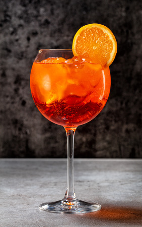 glass of italian aperol spritz cocktail on dark grey table Stock Photo