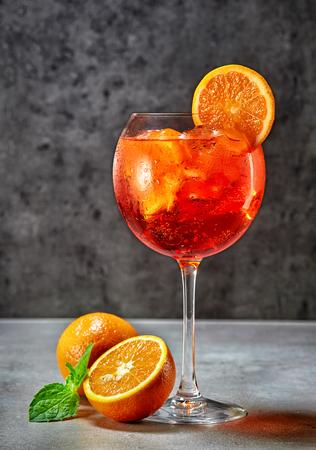 glass of italian aperol spritz cocktail on dark table Stock Photo