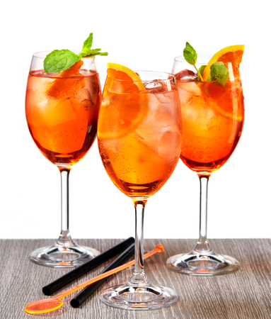 glasses of aperol spritz cocktail on grey wooden table isolated on white background Stock Photo