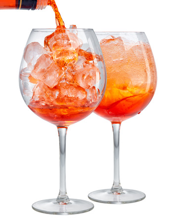 two glasses of aperol spritz cocktail isolated on white background