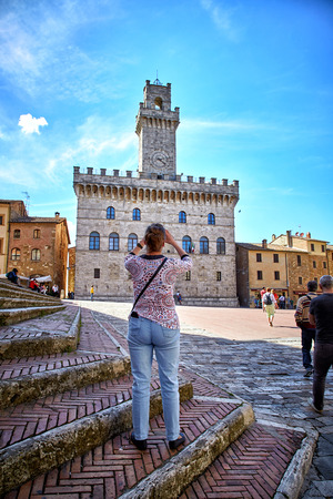 Montepulciano, Italy - MAY 5, 2017: Palazzo Comunale (Town Hall) in Piazza Grande, Antique Montepulciano town, Tuscany Editorial