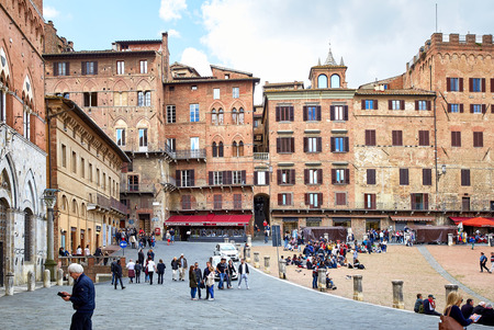 Siena, Italy - MAY 4, 2017: View of Piazza del Campo main square in the city center of Siena, famous for its horse race and parade called Palio di Siena. Located in the Tuscany region