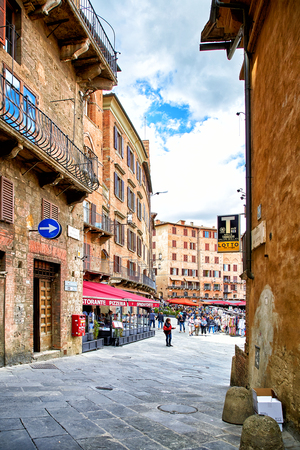 Siena, Italy - MAY 4, 2017: Street view of historic city Sienna Editorial