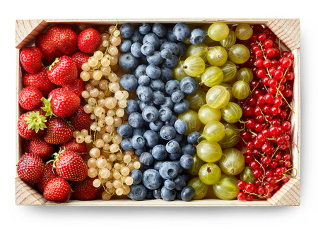 wooden box of various berries isolated on white background, top view Stock Photo