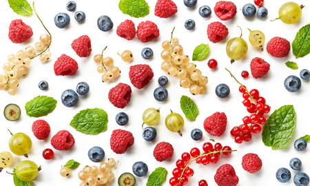 Various fresh berries on a white background, top view
