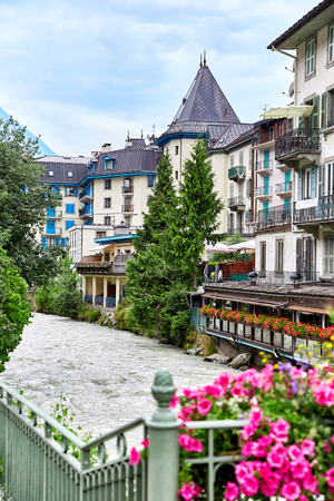 View of Arve river, buildings of Chamonix Mont Blanc, French Alps, selective focus