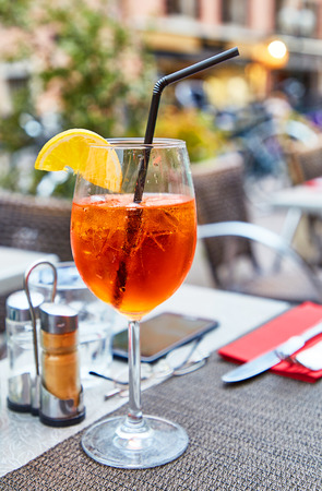 spritz: Glass of Aperol Spritz cocktail on summer restaurant table Stock Photo