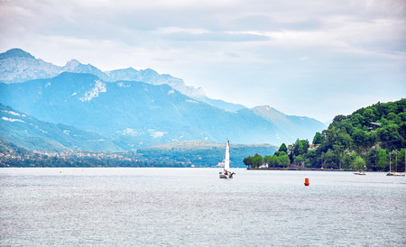 Panoramic view of Lake Annecy in France. Lake Annecy is a perialpine lake in Haute Savoie in France. It is the third largest lake in France.