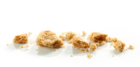crumbs of cookie macro isolated on white background Stock Photo