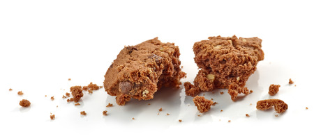 crumbs of chocolate cookie macro isolated on white background Stock Photo