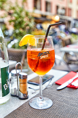 Annecy, France - JULY 19, 2017: Glass of Aperol Spritz cocktail on summer restaurant table