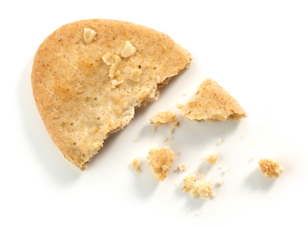 Cookie pieces and crumbs isolated on white background, top view Stock Photo