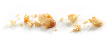 Cheese cookie crumbs macro isolated on white background Stock Photo