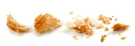 Croissant crumbs macro isolated on white background Stock Photo
