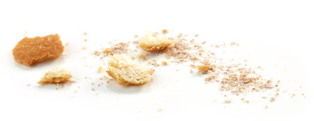 Bread crumbs macro isolated on white background, selective focus