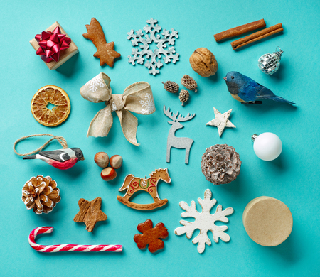 various Christmas decorations on blue background, top view