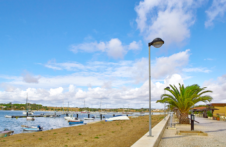 View of fishermens boats and promenade in Alvor city, Portugal