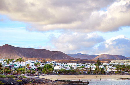 Costa Teguise, Canary Islands, Spain - november 30, 2017: View of Costa Teguise town and beach in Lanzarote Island. Coastline of Atlantic Ocean and beautiful cloudy sky