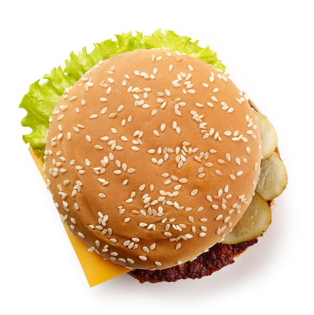 fresh cheeseburger isolated on white background, top view