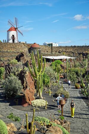 Lanzarote, Spain - DECEMBER 02, 2017: Tourists are walking in  Cactus garden Jardin de Cactus, Canary Islands Editorial