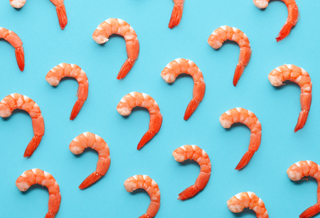 pattern of boiled prawns on blue background Stock Photo