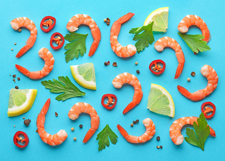 pattern of prawns and spices on blue background