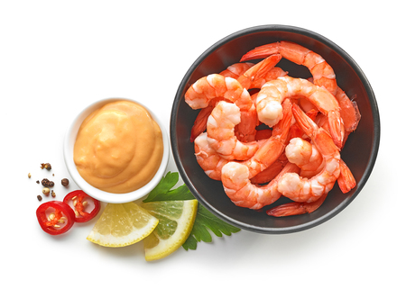 bowl of boiled gambas and salca sauce isolated on white background, top view Stock Photo