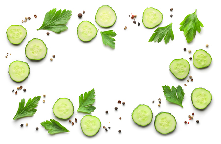 frame of fresh cucumbers and spices on white background, top view Stock Photo