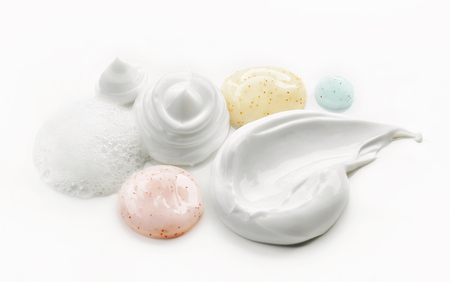composition of various cosmetic creams on white background
