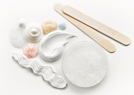 composition of various cosmetic creams on white background, top view