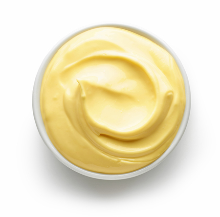 bowl of mayonnaise isolated on white background, top view Stock Photo