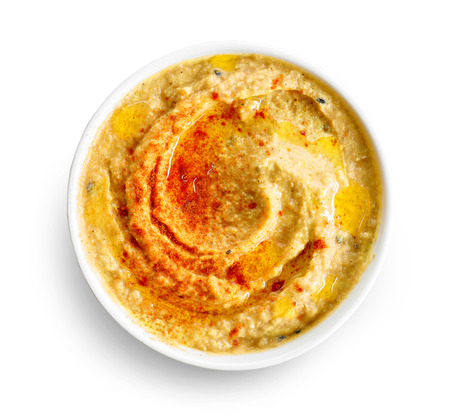 bowl of hummus isolated on white background, top view