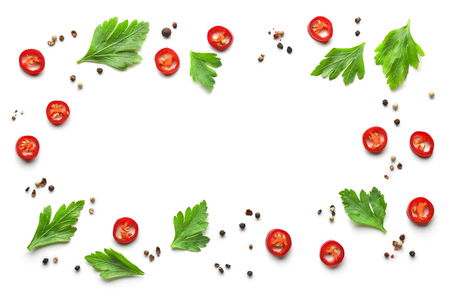 frame of various spices on white background