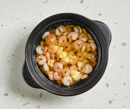 bowl of spicy garlic prawns fried in olive oil, top view Stock Photo