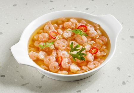 bowl of spicy garlic prawns fried in olive oil