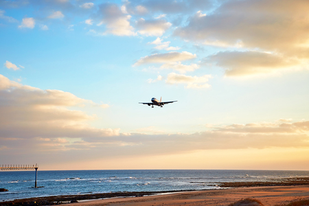 Beautiful Lanzarote island landscape with airplain at sunset