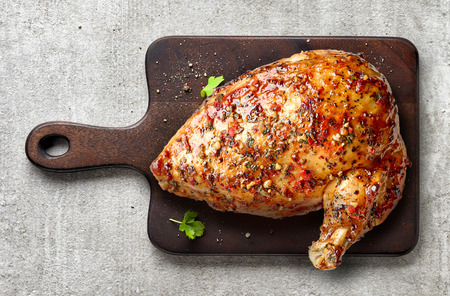 roasted chicken breast on wooden cutting board, top view Stock Photo