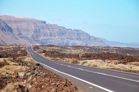 Landscape with road of Lanzarote Island, Canaries, Spain Stock Photo
