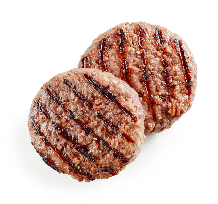 Carne de hamburguesa recién asada aislado sobre fondo blanco, vista superior