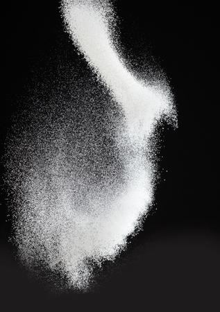 fluffy powdered sugar on black background