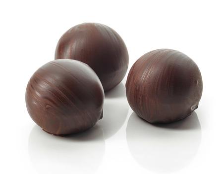 chocolate truffle balls macro isolated on a white background