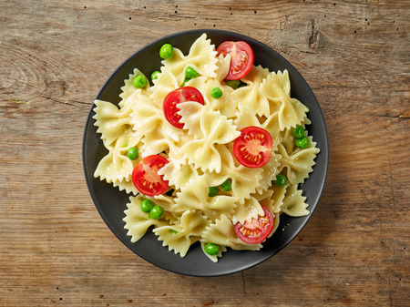 Plate of pasta on wooden table, top view Stock Photo