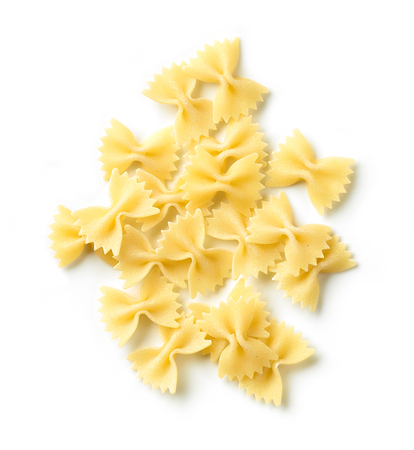 Fresh pasta Farfalle isolated on white background, top view
