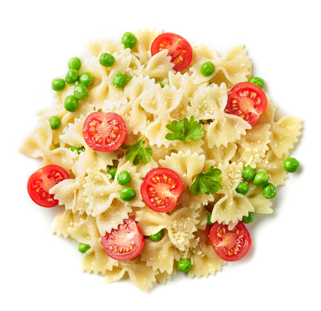 Pasta farfalle with cheese and vegetables isolated on white background, top view