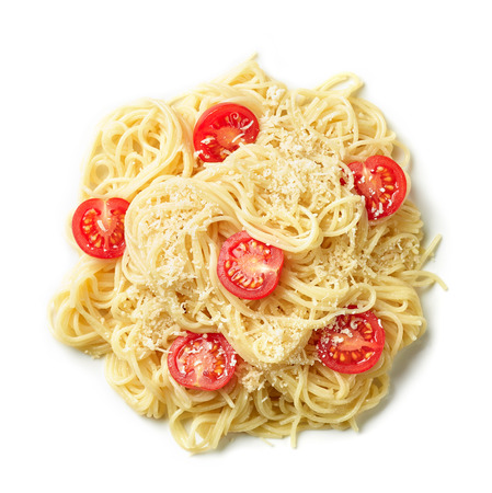 Pasta spaghetti with cheese and tomatoes isolated on white background, top view