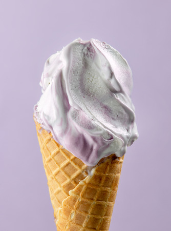 Blueberry ice cream in waffle cone