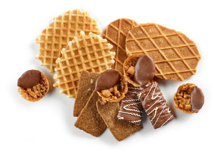 Various waffles and cookies isolated on white background