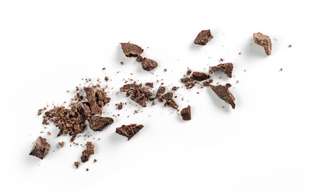 Small chocolate crumbs isolated on white background