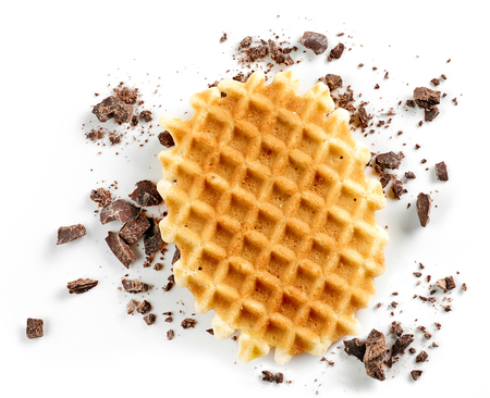 Round waffle and small chocolate crumbs isolated on white background Stock fotó