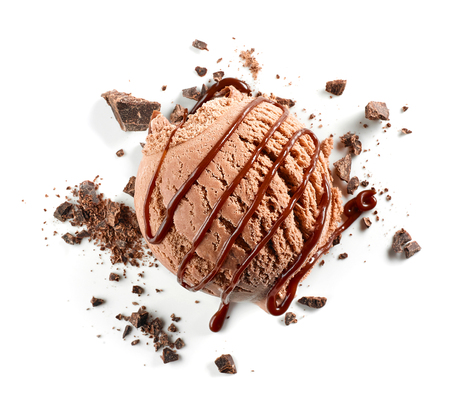 Chocolate ice cream ball with sauce and crumbs isolated on white background